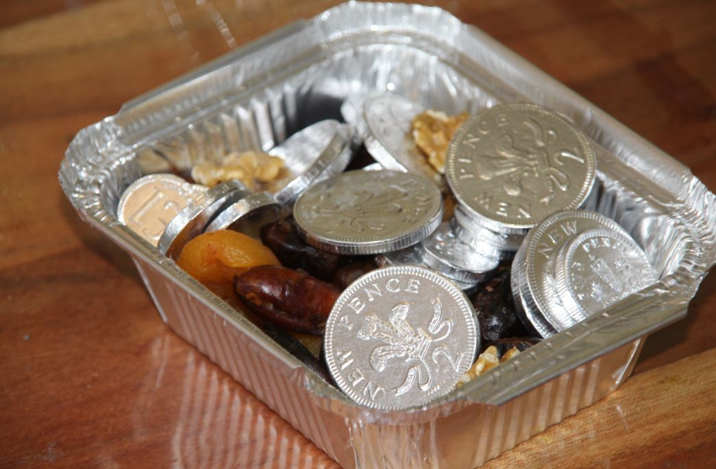Chocolate coins in tray with fruits, for Hanukka.
