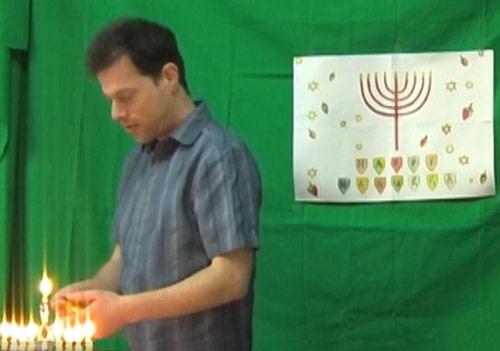 Lighting up the Menora, on Hanuukah holiday. Photo © Gil Dekel.
