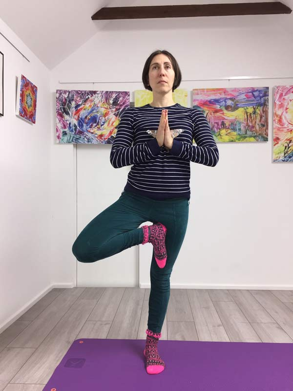 Yoga teacher Natalie Dekel, Tree posture. Yoga classes in Southampton.