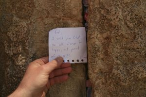 For thousands years people place notes with prayers between the stones of the Western Wall. Here is my note (sending good wishes to God...) Jerusalem, Israel. (Photo: Gil Dekel, 2019).
